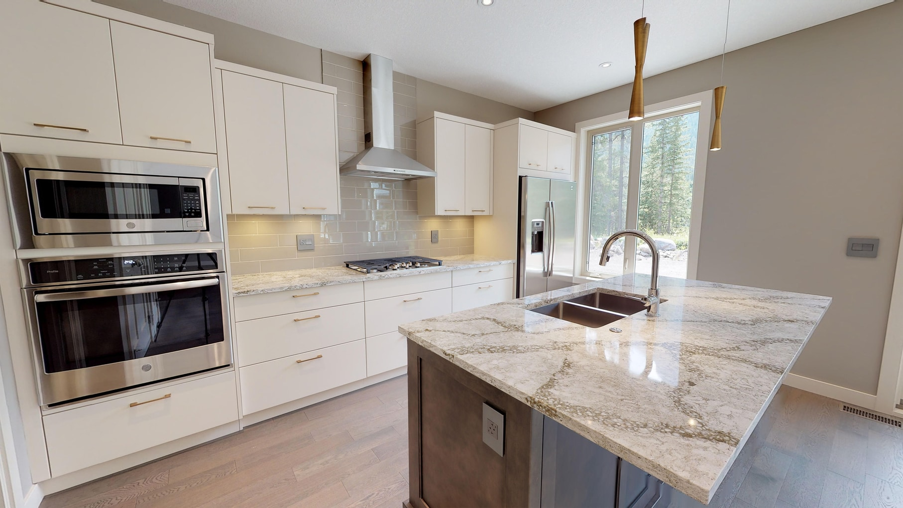 A kitchen view of our custom home, the Carrionton Unit.